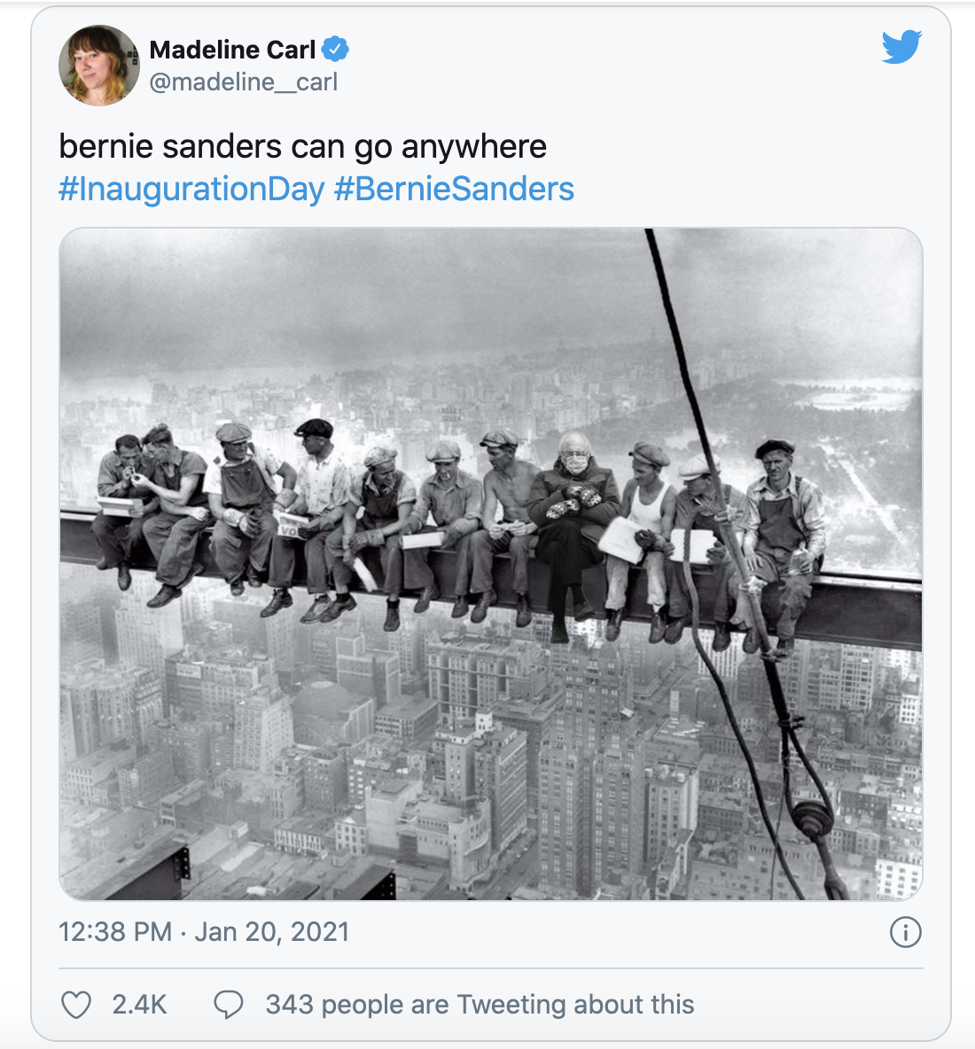 Bernie's meme sitting on pole with workers
